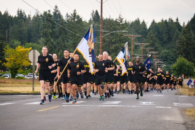 The I Corps command team, Lt. Gen. Gary Volesky and Command Sgt. Maj. Walter Tagalicud, lead the formation during the I Corps Army Birthday run. (U.S. Army photo by Sgt. 1st Class Miriam Espinoza)