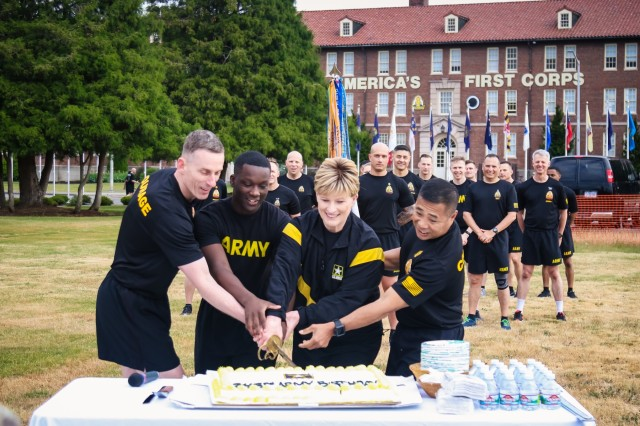 The I Corps command team, Lt. Gen. Gary Volesky and Command Sgt. Maj. Walter Tagalicud, cut the cake with the youngest and oldest Soldiers during the I Corps Army Birthday celebration. (U.S. Army photo by Sgt. 1st Class Miriam Espinoza)