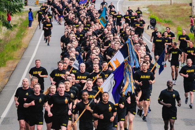 America's First Corps Commander, Lt. Gen. Gary Volesky, leads nearly 20,000 Soldiers in celebration of the Army's 243rd birthday by running four miles on June 14, 2018, at Joint Base Lewis-McChord. This year's Army birthday coincided with I Corps' Centennial Birthday and marked the first time that the entirety of the unit has run in a single formation in almost a decade. (U.S. Army photo by Sgt. Kyle Larsen)