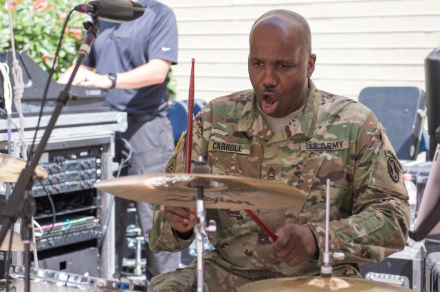 Master Sgt. Francis Carroll plays the drums prior to the Army's 243rd birthday celebration held in the Pentagon courtyard June 14, 2018.