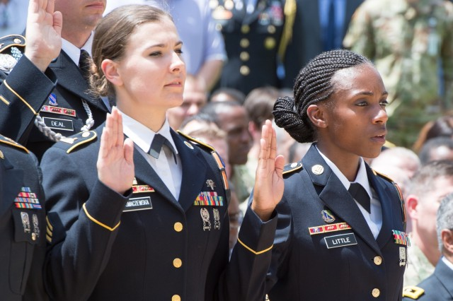 Chief of the Staff of the Army Gen. Mark A. Milley administers the oath of enlistment to a select group of Soldiers during the Army's 243rd birthday celebration held in the Pentagon courtyard June 14, 2018.