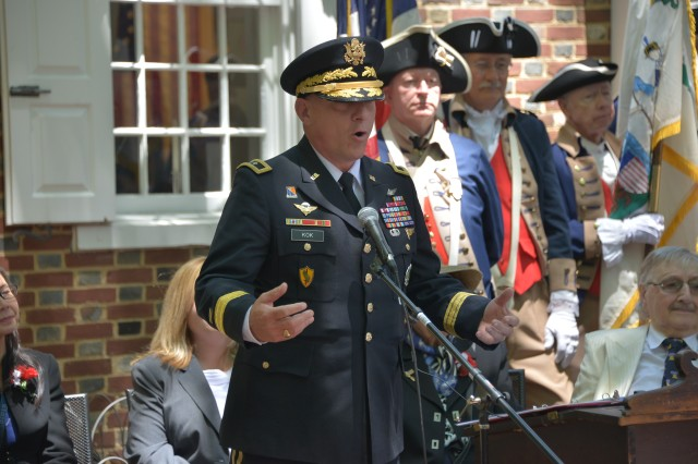 Philadelphia - Maj. Gen. Troy D. Kok, commanding general of the 99th Readiness Division, U.S. Army Reserve, welcomes 13 new U.S. citizens during a naturalization ceremony here June 14, 2018, during Philadelphia's Stripes and Stars festival. The festival celebrated Flag Day and the 243rd U.S. Army birthday with various celebrations and demonstrations throughout the day.