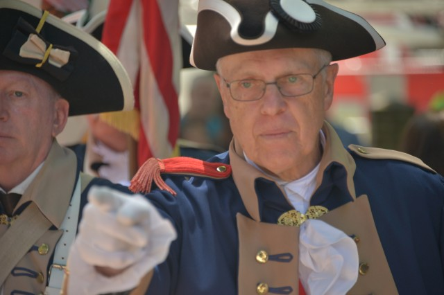 A member of the Philadelphia Continental Chapter, Sons of the American Revolution, signals the color guard movement during a Flag Day ceremony here June 14, 2018. Flag Day and the U.S. Army Birthday are celebrated on the same day, and both commemorations were honored during Philadelphia's Stripes and Stars festival.