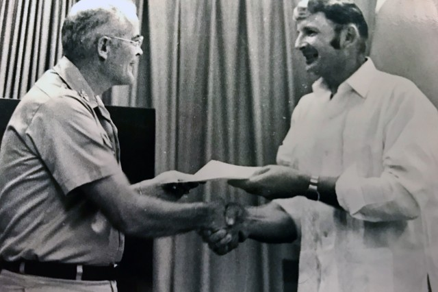 Alfred Budris receives a Commander's Award for Civilian Service from the commander, Headquarters, U.S. Army Garrison Okinawa in 1973. (Courtesy photo) (Photo Credit: U.S. Army)
