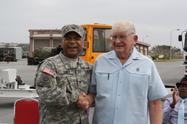 Col. Michael Lopez, 403rd Army Field Support Brigade commander, and Alfred Budris. Lopez welcomes the Logistics Readiness Center-LRC Torii Station to the brigade in October 2012. (Courtesy photo) (Photo Credit: U.S. Army)
