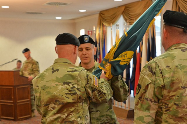 Lt. Col Matthew A. Price receives the battalion colors from outgoing commander Lt. Col. Charles W. McPhail at a change of command ceremony June 14 at Tower Barracks in Grafenwoehr, Germany. Price arrives from the Joint Multinational Readiness Center in Hohenfels, Germany.