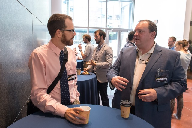Geoff Slipher (right), the U.S. Army Research Laboratory's Autonomous Systems Division chief speaks with Army researcher Chris Kroninger June 6, 2018, at the Robotics Collaborative Technology Alliance review at the University of Pennsylvania.