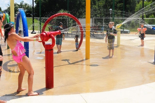 Children enjoy the spray park at SPLASH!