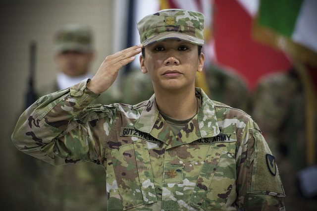 Maj. Geraldine Gutzwiler, executive officer, Army Field Support Battalion-Kuwait, salutes as the Commander of Troops during a change of command ceremony for the AFSBn-Kuwait at Camp Arifjan, Kuwait, June 15. (U.S. Army Photo by Justin Graff, 401st AFSB Public Affairs)