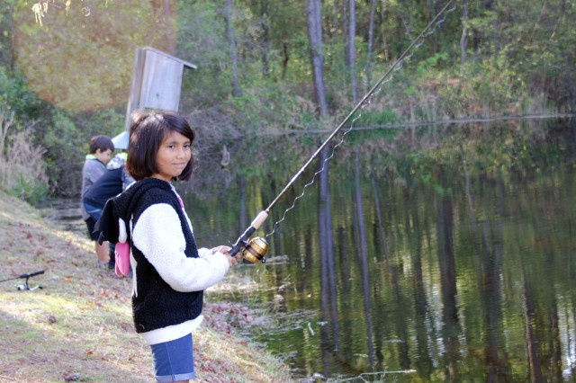 A participant in a Youth Fishing Derby held early this year waits for the fish to bite at Heise Pond on post. Since early February Fort Jackson has been using iSportsman, an online application designed to help outdoor enthusiasts sign in for cycling, hunting and fishing activities on post.
