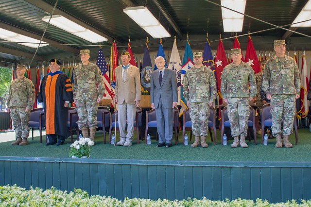 The official party for graduation of the Command and General Staff Officer's Course Class 2018 (l-r) Col. Robert Ault, Director of the Command and General Staff School; Dr. James Martin, Dean of Academics; Brig. Gen. Scott Efflandt, Deputy Commandant; Col. (U.S. Army, Retired) Roger Donlon, Medal of Honor Recipient; Lt. Gen. (U.S. Army, Retired) Robert Arter; Cmd. Sgt. Maj. Eric Dostie, Combined Arms Center; Lt. Gen. Michael Lundy, Commander Combined Arms Center and Commandant Command and General Staff College; and GEN James C. McConville, Vice Chief of Staff of the Army.