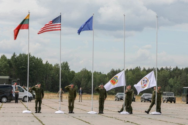 Soldiers from the Lithuanian military lower the Saber Strike and Thunder Storm 18 exercise colours during a closing ceremony at Rukla Air Field, Lithuania, June 15, 2018. 18,000 participants from 19 allied and partner nations participated in the eighth iteration of Saber Strike from June 3 - 15. The next iteration is scheduled for 2020.