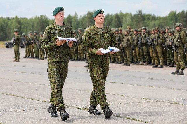 Soldiers from the Lithuanian military deliver the Saber Strike and Thunder Storm 18 exercise colours to designated representatives during the closing ceremony at Rukla Airfield, Lithuania, June 15, 2018. 18,000 participants from 19 allied and partner nations participated in the eighth iteration of Saber Strike, June 3 - 15. The next iteration is scheduled for 2020.