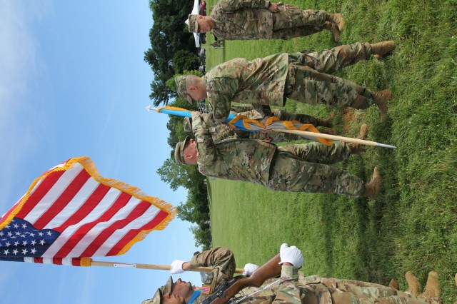 FORT GEORGE G. MEADE, Md. - Col. Brian Vile, the commander of the 780th Military Intelligence Brigade (Cyber), returns the brigade colors to Command Sgt. Maj. James Krog, during a change of command ceremony hosted by Maj. Gen. Gary Johnston, commander of the U.S. Army Intelligence and Security Command (INSCOM) on the McGlaclin Parade Field June 14.