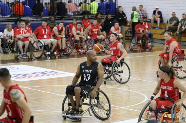 "U.S. Army Spc. Brent Garlic hustles back on defense during a preliminary round wheelchair basketball game against Team Marine Corps June 4, 2018, at the U.S. Air Force Academy's Cadet Center Gymnasium during the 2018 Department of Defense Warrior Games. Garlic was designated the ""Heart of the Team,"" for Team Army. The DoD Warrior Games were conducted from June 1 - 9. It is an adaptive sports competition for wounded, ill and injured service members and veterans. Approximately 300 athletes representing teams from the Army, Marine Corps, Navy, Air Force, Special Operations Command, United Kingdom Armed Forces, Canadian Armed Forces, and the Australian Defence Force competed in archery, cycling, track, field, shooting, sitting volleyball, swimming, wheelchair basketball, powerlifting and indoor rowing. (U.S. Army photo by Robert Whetstone)"