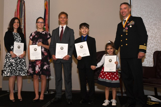 Navy Cmdr. Jason Brianas' family was recognized for their support of Brianas's career during a retirement ceremony June 7. Pictured left to right are: wife Lea, children Meghan, Nathan, Alexander and Anastasia, and Brianas.