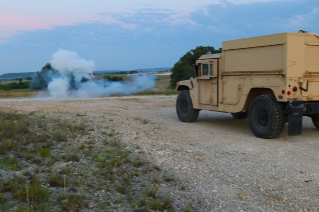 Soldiers with the Maintenance Support Team, Headquarters and Headquarters Company, 504th Military Intelligence Brigade, Fort Hood, Texas, stop their vehicle due to simulated indirect fire June 7, 2018. Soldiers were tasked to recover a vehicle while under direct fire and a chemical attack. (U.S. Army photo by Sgt. Melissa N. Lessard)