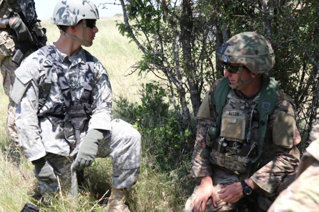 1st Lt. Matthew Aiton (Right), 3rd Cavalry Regiment Fort Hood, Texas, explains to Cdt. Dominick Giovannelli, F Company, 3rd Regiment, West Point, how to assemble maps and a portable dry erase board in the field. The cadets are participating in Cadet Troop Leader Training, where they shadow Lieutenants, during the month of June. (U.S. Army photo by Sgt. Melissa N. Lessard)
