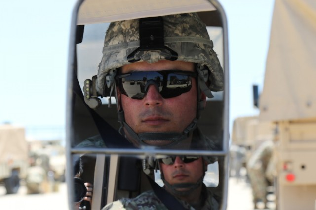 Staff Sgt. Efrain Fuentesrivera, 303rd Military Intelligence Battalion, 504th Military Intelligence Brigade, Fort Hood, Texas, waits in his vehicle prior to they convey May 30, 2018. His unit was going on a field training exercise as a part of a validation exercise. (U.S. Army photo by Sgt. Melissa N. Lessard)