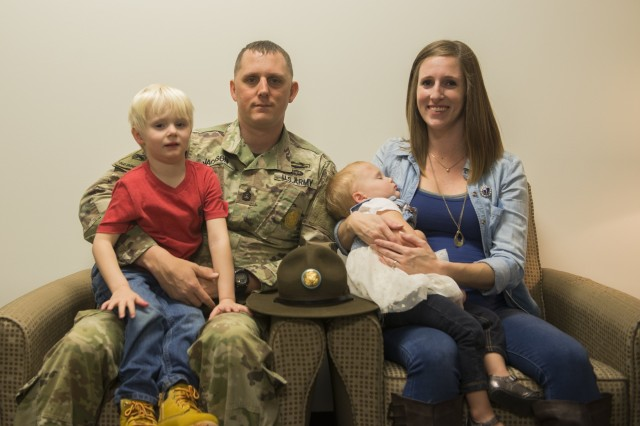 FORT BENNING, Ga. (June 18, 2018) - In this photo from earlier in 2018, Sgt. 1st Class Cory Jackson, second from left, and wife Jennifer Jackson, right, sit with son Evan, left, and daughter Olivia, second from right. Sgt. 1st Class Cory Jackson has served as a drill sergeant in Bravo Company, 1st Battalion, 46th Infantry Regiment, at Fort Benning, Georgia, for the past two years and said this assignment has taught him about himself and the importance of a resilient, supportive Family. (U.S. Army photo by Megan Garcia, Maneuver Center of Excellence, Fort Benning Public Affairs)