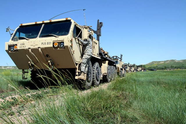 Soldiers from the 137th Transportation Company, Kansas Army National Guard, convoy to Red Shirt, S.D., June 15, 2018. These military vehicles allow large amounts of timber to be delivered to Native American reservations in support of the timber haul operation and Golden Coyote training exercise.