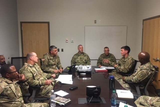 Capt. Joseph Carothers, HHC Commander, discusses leadership best practices with Col. Matthew St Laurent, MEDCOM Deputy Chief of Staff for Warrior Care and Transition, and other WCT leadership. (Photo by Mr. Andre L. Revell II)