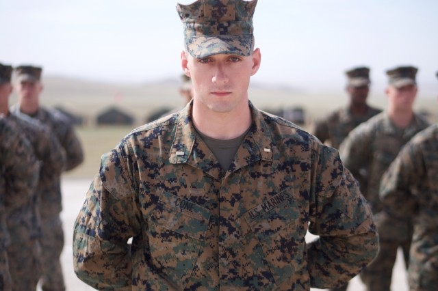 U.S. Marine Corps 2nd Lt. Anthony Cone, platoon leader for the Marine Corps Forces, Pacific, contingent at Khaan Quest 18, stands at the head of the platoon June 14, 2018, at Five Hills Training Area, Mongolia, before the opening ceremony for the exercise. Khaan Quest 18 is a combined (multinational) joint (multi-service) training exercise designed to strengthen the capabilities of U.S., Mongolian and other partner nations in international peace support operations. (U.S. Army National Guard photo by Sgt. David Bedard/Released)