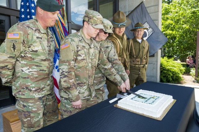 (From left to right) Lt. Col. Bryan Martin, garrison commander, Natick Soldier Systems Center (NSSC), along the youngest Soldier, PV2 Ricky Pena, a human research volunteer assigned to HRDD, and oldest Soldier, Lt. Col. Michael Boye, U.S. Army Research Institute of Environmental Medicine, participate in a traditional cake-cutting ceremony for the Army's 243rd birthday. As 2018 marked one hundred years since the end of World War I, the Soldiers used an authentic WWI bayonet instead of the usual sword.
