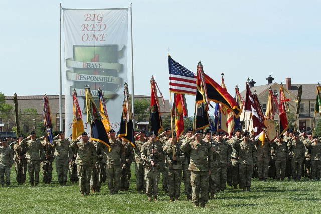 Soldiers representing units of the 1st Infantry Division render salutes as the national anthem is played during the 1st Infantry Division Change of Command Ceremony at Cavalry Parade Field, Fort Riley, Kansas June 8. (Chad L. Simon, 1st Inf. Div. Public Affairs)