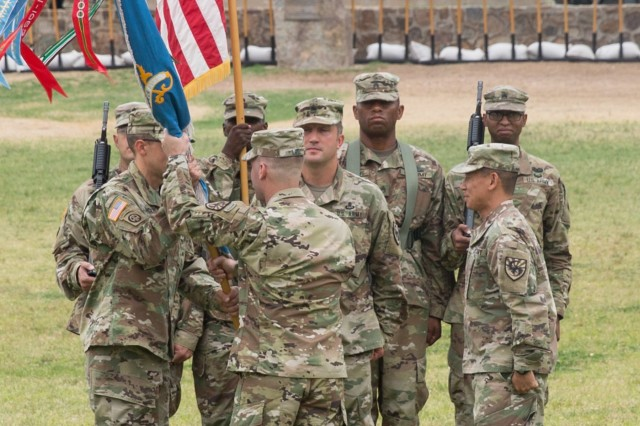 Lt. Col. JD Finch, the incoming commander of the 304th Military Intelligence Battalion, receives the battalion colors from Col. Brian Lieb, Commander of the 111th Military Intelligence Brigade, during a Change of Command Ceremony on Brown Parade Field, Fort Huachuca June 15.
