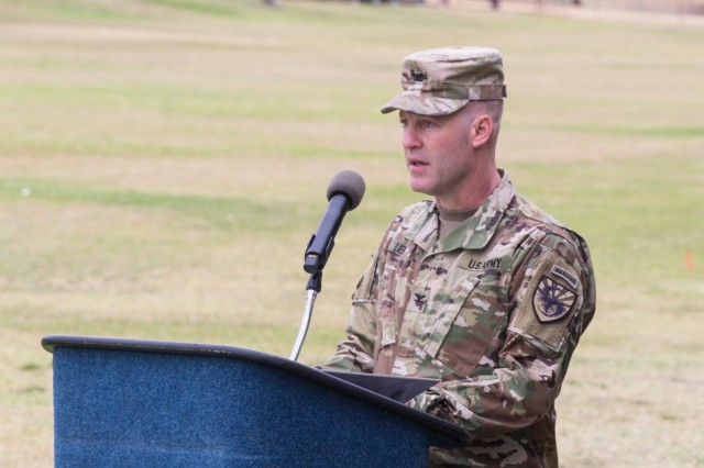 The reviewing officer, Col. Brian Lieb, Commander of the 111th Military Intelligence Brigade, makes remarks during a Change of Command Ceremony on Brown Parade Field, Fort Huachuca June 15.