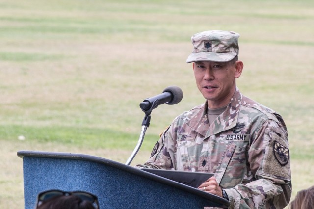 Lt. Col. Paul Oh, the outgoing commander of the 304th Military Intelligence Battalion, makes remarks during a Change of Command Ceremony on Brown Parade Field, Fort Huachuca June 15.