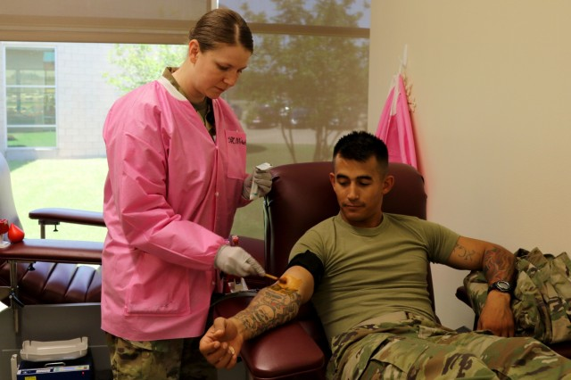 Staff Sgt. Joshua Mubarak, a fire support noncommissioned officer with Headquarters and Headquarters Battery, Field Artillery Squadron, 3rd Cavalry Regiment, prepares to donate blood during the squadron's blood drive June 5, 2018, at the Robertson Blood Center, Fort Hood, Texas.