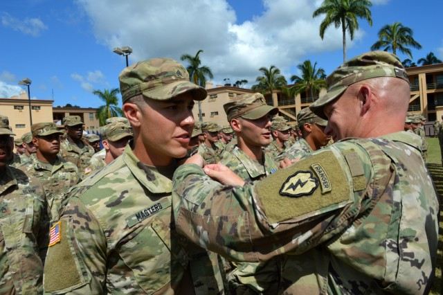 Command Sgt. Maj. Michael J. Spear, senior enlisted advisor, 3rd Brigade Combat Team, 25th Infantry Division, pins on the Expert Infantryman Badge on an awardee at Schofield Barracks, Hawaii, on June 15, 2018.  Infantrymen throughout the 25th ID are participating in this biannual event to earn the prestigious Expert Infantryman Badge. (U.S. Army photo by Staff Sgt. Armando R. Limon, 3rd Brigade Combat Team, 25th Infantry Division)