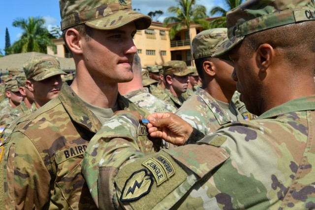 Maj. Gen. Ronald P. Clark, commander, 25th Infantry Division, pins on the Expert Infantryman Badge on an awardee at Schofield Barracks, Hawaii, on June 15, 2018.  Infantrymen throughout the 25th ID are participating in this biannual event to earn the prestigious Expert Infantryman Badge. (U.S. Army photo by Staff Sgt. Armando R. Limon, 3rd Brigade Combat Team, 25th Infantry Division)