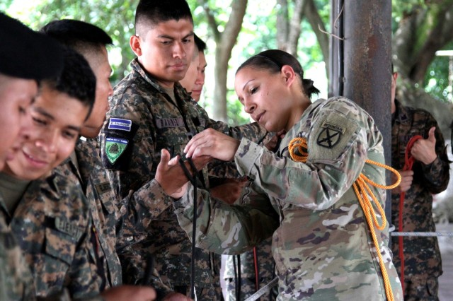 1st. Lt. Katrina F. Simpson, Infantry officer, New Hampshire Army National Guard, demonstrates the basics of knot tying to a group of El Salvadoran humanitarian response soldiers in San Juan Opico, El Salvador, June 5, 2018.