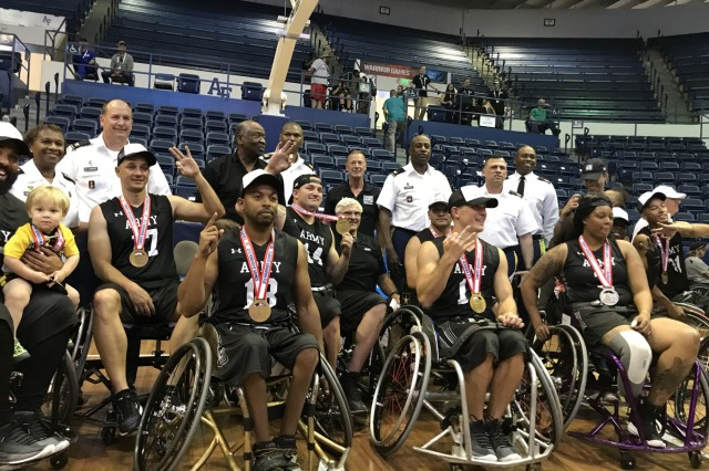 Team Army is all smiles after winning a gold medal during the   2018 Department of Defense Warrior Games for the year in a row. The DoD Warrior Games is an adaptive sports competition for wounded, ill and injured service members and veterans. Approximately 300 athletes representing teams from the Army, Marine Corps, Navy, Air Force, Special Operations Command, United Kingdom Armed Forces, Canadian Armed Forces, and the Australian Defence Force.  Participants competed  in archery, cycling, track, field, shooting, sitting volleyball, swimming, wheelchair basketball, and - new this year - powerlifting and indoor rowing. (Photo by Annette P. Gomes.)