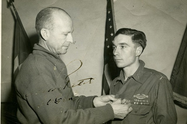 1st Lt. Garlin Conner receives one of his commendations during World War II. Conner risked his life against insurmountable odds the morning of January 24, 1945, in the woods of eastern France. Conner's direction as a field artillery guide resulted in the destruction of six German Panzer tanks, and the deaths of 50 German soldiers. His acts of bravery saved numerous lives from his Army company. For his actions, he will be posthumously awarded the Medal of Honor in a White House ceremony June 26, 2018.