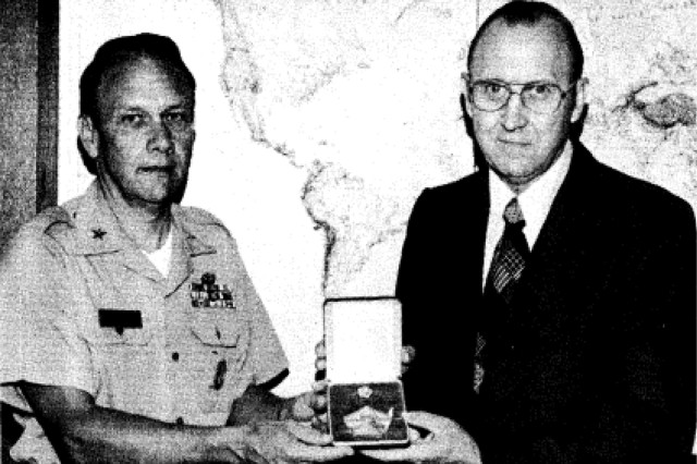 Brig. Gen. John Jones presents Dr. McClung with the Army's Outstanding Achievement in Materiel Acquisition award in June 1976.