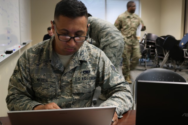 U.S Air Force Senior Airman David F. Merida, assigned to the 112th Cyber Operations Squadron, studies information for the day one scenario plans during the Cyber X-Games 2018, hosted by the Army Reserve Cyber Operations Group (ARCOG), 335th Signal Command Theater and The University of Texas at San Antonio (UTSA), June 13 at UTSA. The Cyber X-Games is a five-day exercise facilitated by military and academia partnerships consisting of survey and reconnaissance of the cyber environment, inject detection and response and live red/blue teaming. This year's games focused on the protection of critical network infrastructures in the areas of finance, public utilities and health care. This year's games focused on the protection of critical network infrastructures in the areas of finance, public utilities and health care.