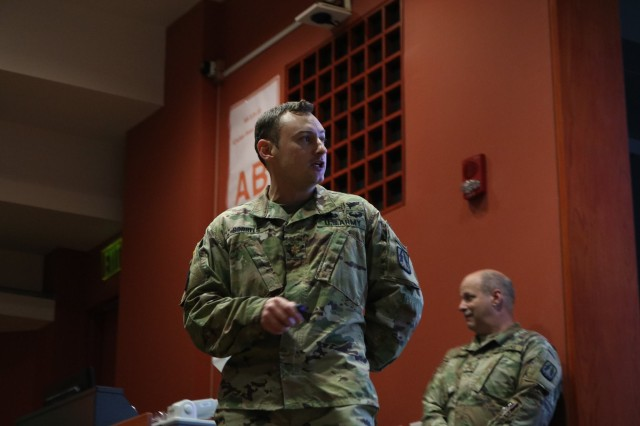 U.S Army Major Tyler Sorrels, currently assigned to the Western Cyber Protection Center, Army Reserve Cyber Operations Group (ARCOG), 335th Signal Command (Theater), gives the final brief with his team during the 2018 Cyber X-Games, hosted by the ARCOG and The University of Texas at San Antonio (UTSA), June 17 at UTSA. Sorrels and his team were among the top three finishers for the Competion. The Cyber X-Games is a five-day exercise facilitated by military and academia partnerships consisting of survey and reconnaissance of the cyber environment, inject detection and response, and live red/blue teaming. This year's games focused on the protection of critical network infrastructures in the areas of finance, public utilities and health care.
