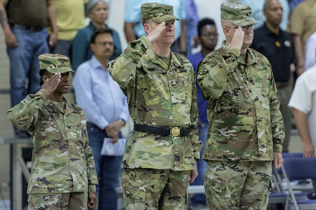Left to right: Col. Carmelia Scott-Skillern, outgoing commander, 401st Army Field Support Brigade, Maj. Gen. Duane Gamble, commanding general, U.S. Army Sustainment Command, and Col. Jeffrey Niemi, incoming commander, 401st AFSB, salute during a change of command ceremony for the 401st AFSB at Camp Arifjan, Kuwait, June 18. (U.S. Army Photo by Justin Graff, 401st AFSB Public Affairs)