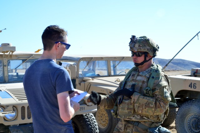 Col. Robert Magee, commander of the 3rd Brigade Combat Team, 1st Armored Division, discusses his brigade's operations and the integration of cyberspace operations into its concept of maneuver with Military Times reporter Mark Pomerleau in an interview during the 3rd BCT's participation in Decisive Action Rotation 18-08 at the National Training Center at Fort Irwin, Calif., June 6, 2018. To enable and develop the cyber capabilities of brigades training at NTC and merge cyber effects into BCTs' approach to multi-domain operations, elements from U.S. Army Cyber Command's ongoing Cyberspace Electromagnetic Activity Support to Corps and Below program provide tactical cyber forces and incorporate cyberspace planning into brigade mission command and decision-making processes. Embedded with the brigades during their training rotations, cyber warriors both become part of the BCT's operational force and enable its staff to unite cyber efforts with key related warfighting disciplines such as intelligence, reconnaissance, communications, electronic warfare and information operations.