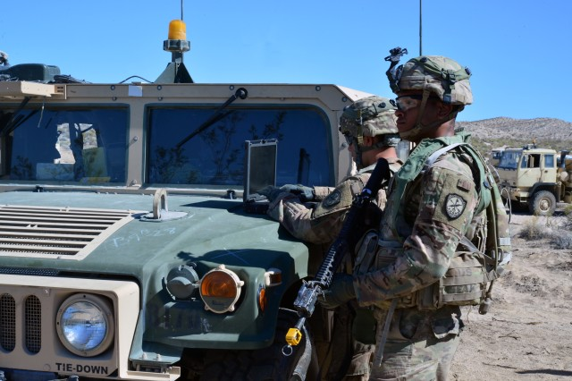 Soldiers of the 780th Military Intelligence Brigade embedded with the 3rd Brigade Combat Team, 1st Armored Division, establish a location to conduct cyberspace operations during Decisive Action Rotation 18-08 at the National Training Center at Fort Irwin, Calif., June 6, 2018.