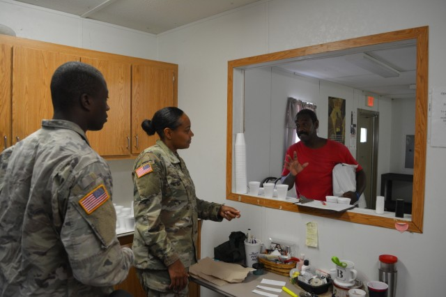 COLUMBUS, Ga. (June 18, 2018) -- From left, 2nd Lt. Exaviar Godsey, 3rd Battalion, 121st Infantry Regiment, and 2nd Lt. Aireal Williams, 3rd Battalion, 16th Cavalry Regiment, talk to Lonzo Murray at Open Door Community, The 3-16 held a Doughnuts for Dads event June 12 at Open Door Community in Columbus, Georgia. (U.S. Army photo by Bryan Gatchell, Maneuver Center of Excellence, Fort Benning Public Affairs)