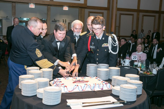 Cutting the cake celebrating the Army's 243rrd birthday are, from left, Command Sgt. Major Rodger Mansker, command sergeant major of the Army Materiel Command; retired Chief Warrant Officer 5 Harry Hobbs; retired Col. Sam Torrey; Joe Fitzgerald, civilian aide to the secretary of the Army; Gen. Gus Perna, commander of the Army Materiel Command; and cadet Jeremy Bailey of the New Century Technology High School JROTC. The cake cutting was part of Army birthday festivities hosted June 15, 2018, by the Huntsville/Redstone Association of the U.S. Army, Huntsville, Ala.
