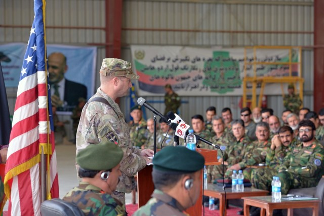 Air Force Brig. Gen. Phillip Stewart, Train, Advise, Assist Command-Air commander, addresses graduates from the first Afghan UH-60 Mission Qualification Training Course at a ceremony held at Kandahar Air Base, Afghanistan. An Army SATMO mission qualification team is training Afghan pilots to fly and conduct combat operations using newly acquired UH-60 Black Hawk helicopters.