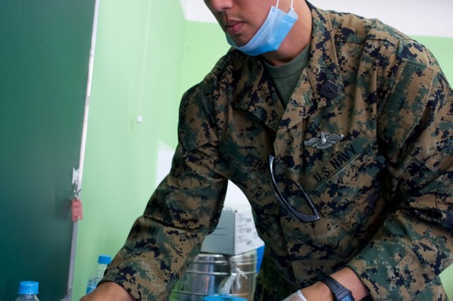 U.S. Navy Hospital Corpsman 2nd Class Nick Cera, 3rd Dental Battalion, lays out vials of local anesthetic June 18, 2018, during the Khaan Quest 2018 Health Services Support Engagement at the 134th School, Ulaanbaatar, Mongolia. Khaan Quest 2018 is a combined (multinational) joint (multi-service) training exercise designed to strengthen the capabilities of U.S., Mongolian and other partner nations in international peace support operations. (U.S. Army National Guard photo by Sgt. David Bedard/Released)