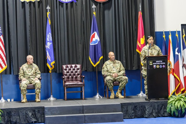 Lt. Col. Roshun Steele addresses the employees of the Anniston Munitions Center during the June 18 Change of Command Ceremony. Pictured with Steele are, from left, Col. Norbert Fochs, commander of the Blue Grass Army Depot, and Lt. Col. Craig McIlwain, outgoing commander for ANMC.