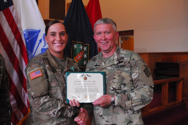 Aberdeen Proving Ground Soldier of the Year, Spc. Kayla Riehl, is presented with the Army Commendation Medal by Brig. Gen. Jim Bonner, commander, 20th Chemical, Biological, Radiological, Nuclear, and Explosives (CBRNE) Command, May 31 at the command's monthly award ceremony at the Edgewood Chapel. Riehl is attached to the 20th CBRNE Headquarters and Headquarters Company and is now in the running for U.S. Forces Command Soldier of the Year. (Photo by Suzan Holl, 20th CBRNE Public Affairs)